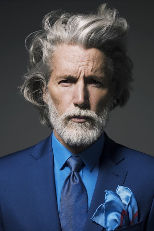 grey wavy hair in suit